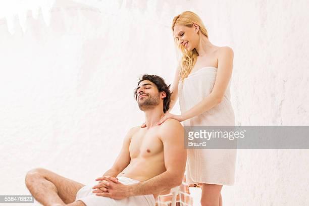 Couple massaging in salt room.