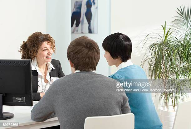 A couple meet with a mortgage adviser