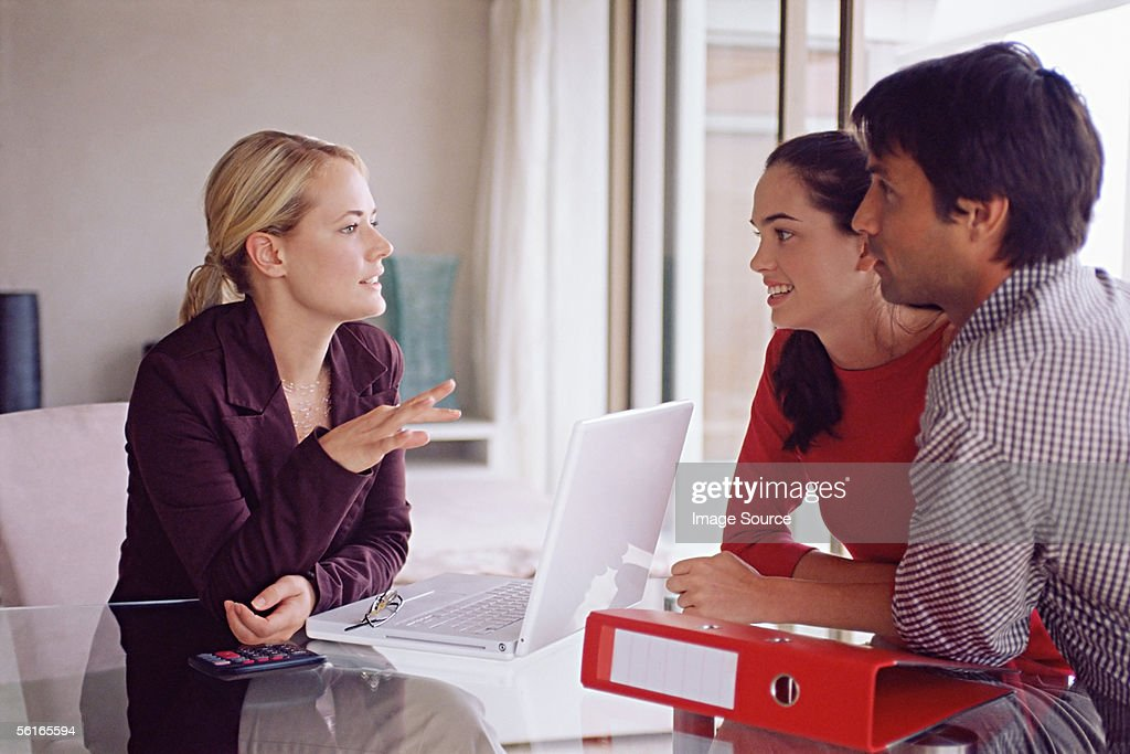 Couple meeting with a financial adviser : Stock Photo