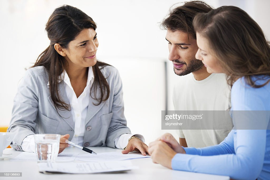 Couple meeting with financial advisor : Stock Photo