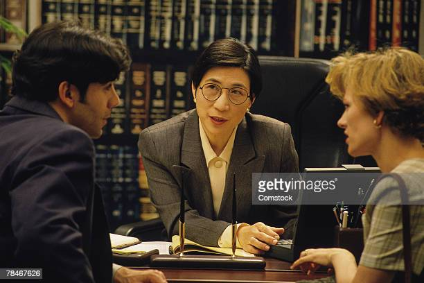 Couple meeting with lawyer or judge