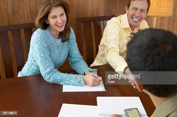 Couple Meeting With Salesman