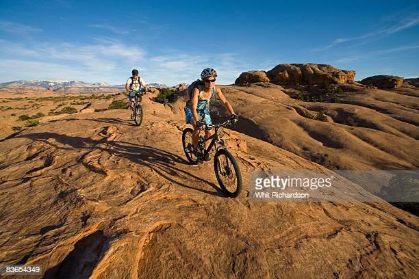 couple mountain biking, Moab, Utah