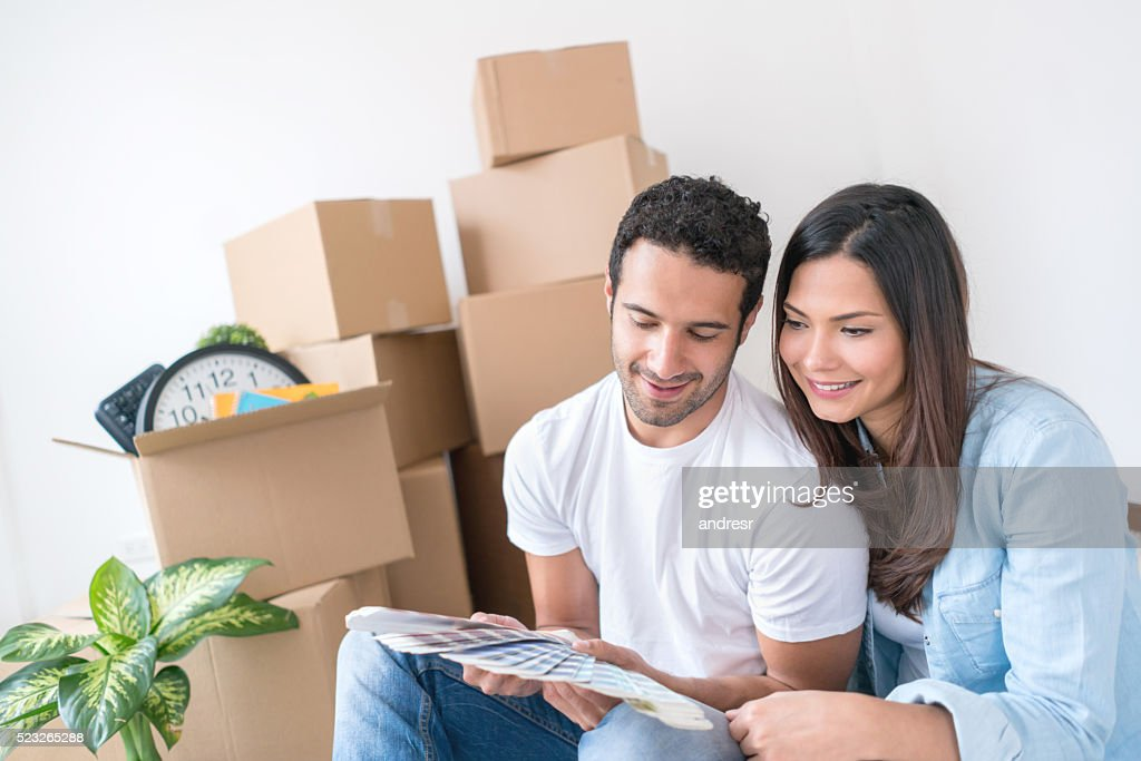 Couple moving and painting their new house