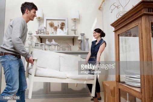 Couple moving sofa