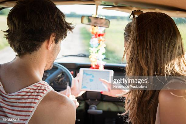 Couple Navigating With Tablet PC