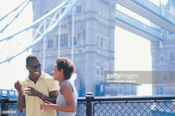 Couple near Tower Bridge, London, England