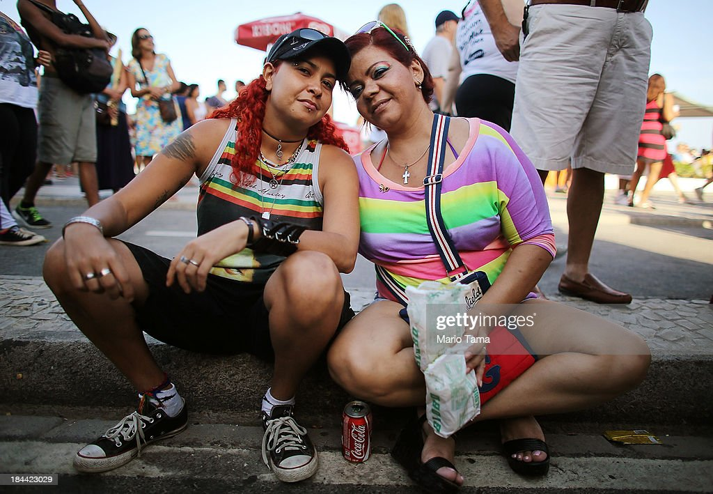Couple Nivea (L) and Claudia, together for seven years, pose during Rio de Janeiro's 18th Gay Pride Parade along Copacabana Beach on October 13, 2013 in Rio de Janeiro, Brazil. Brazil is the world's largest Catholic nation with an estimated 60,000 gay couples. In May, Brazil became the third country in Latin America to effectively approve same-sex marriage via a court ruling, but a final law has yet to be passed.