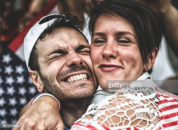 couple of american supporter at the stadium embracing
