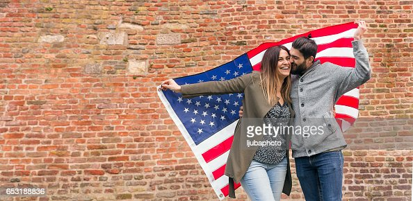 Couple of american supporter happiness for the national holiday : Stock-Foto