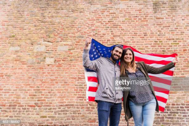 Couple of american supporter happiness for the national holiday