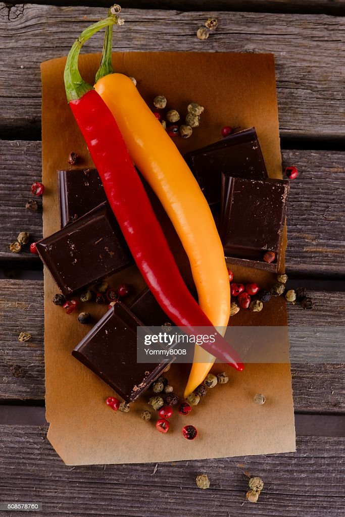 Couple of chili peppers with dark chocolate : Stock Photo