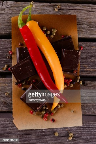 Couple of chili peppers with dark chocolate : Bildbanksbilder