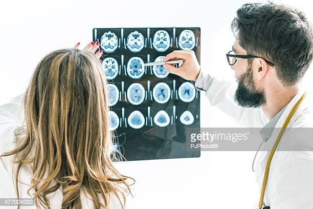 Couple of Doctors examining the x-ray of brain