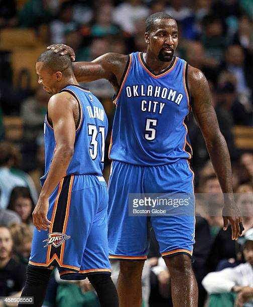 A couple of exCeltics share a moment as Kendrick Perkins right has a pat on the head for Thunder teammate Sebastian Telfair left in the first half...