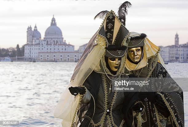 Couple of golden Venetian masks at Grand Canal (XL)