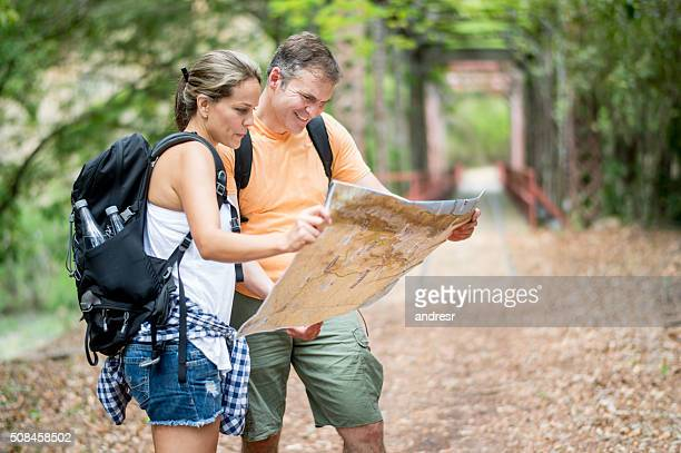 Couple of hikers looking at a map