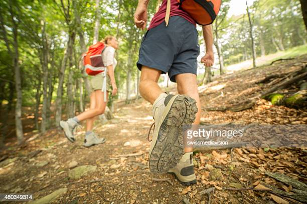 Couple of hikers on mountain trail