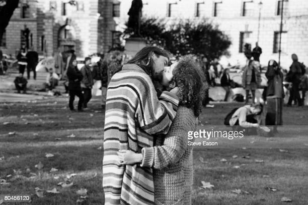 A couple of new age travellers kissing at the Anarchist Festival in Parliament Square London 23rd October 1994