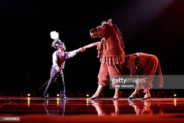 A couple of pantomime horses each inhabited by two artists give the Small Clown a hard time during the Belgian premiere of the Cirque du Soleil show...