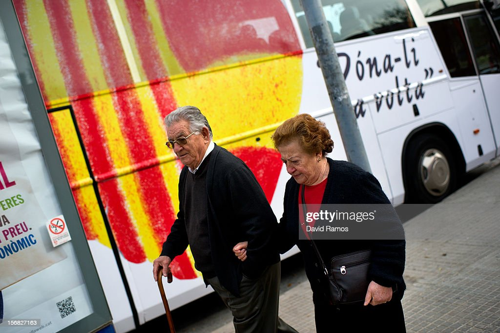 A couple of pensionist walks past a heart composed of a Spanish and a Catalan flag painted on the 'Civic Movement of Spain and Catalans' bus on November 22, 2012 in Barcelona, Spain. This civic movement defends the unity of Spain and asking for voting any Anti-separatist Political Party. Over 5 million Catalans will be voting in Parliamentary elections on November 25, with opinion polls showing majority support for pro-independence parties.