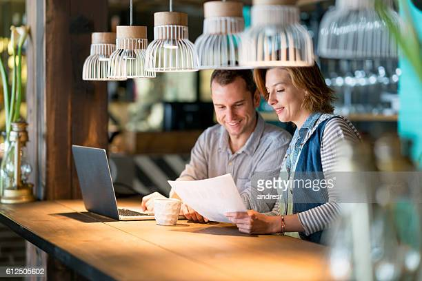 Couple of people working at a cafe