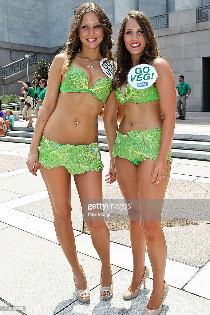 A couple of PETA's Lettuce Ladies pose for a photo during the 'National Veggie Dog Day' event PETA's annual answer to the meat industry's National...