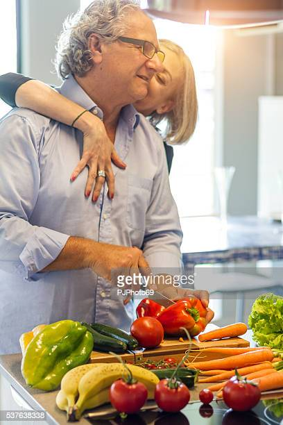 Couple of seniors in love cooking