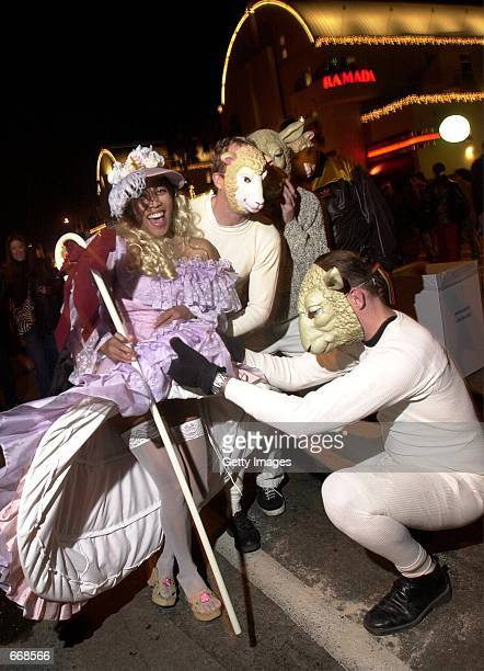 A couple of sheep take a peep at Little Bo Peep during the West Hollywood Halloween Carnival along Santa Monica Boulevard on October 31 2000 in...