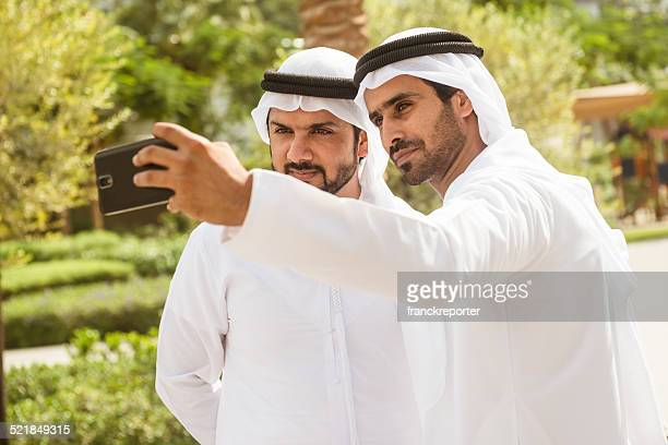 couple of sheikh friends doing a selfie on the city