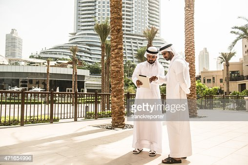 couple of sheikh friends surfing on the cit