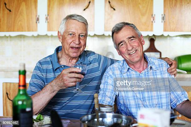 Couple of smiling male seniors at meal time