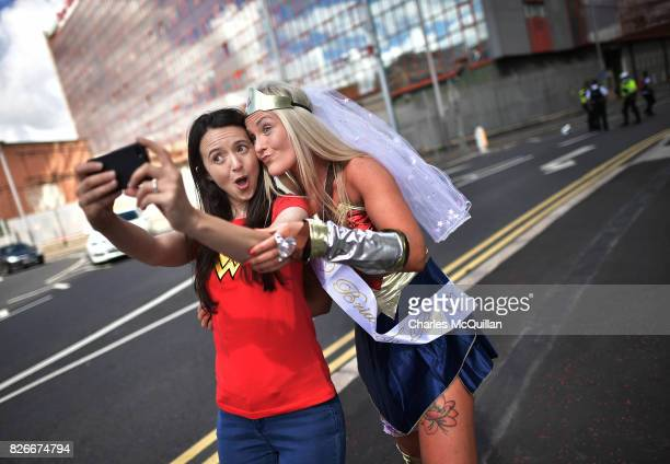 A couple of spectators dressed as Wonder Woman take a selfie as Belfast Gay Pride takes place on August 5 2017 in Belfast Northern Ireland The...