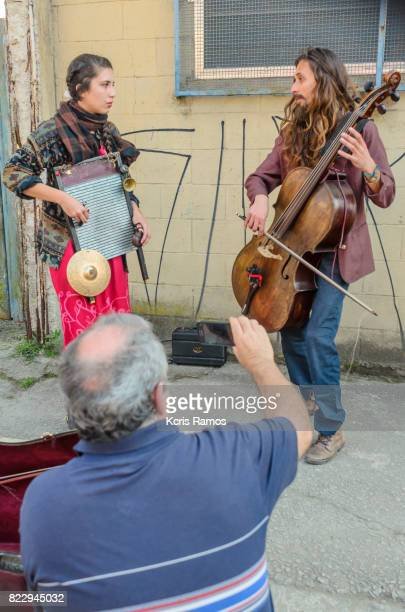 Couple of street musicians performing playing cello