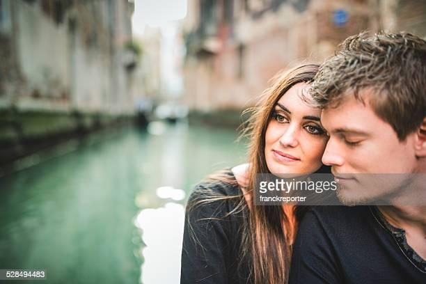 couple of tourist on the gondola in venice