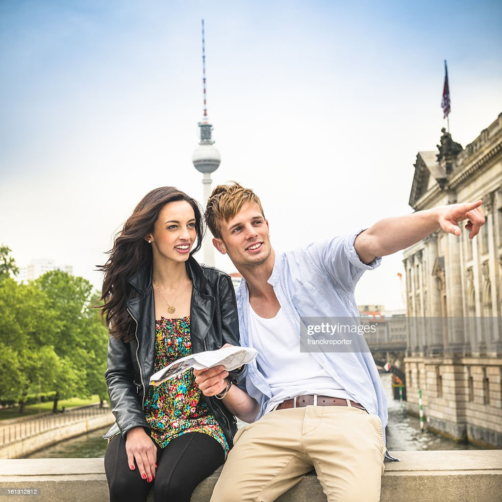 Couple of tourist reading a map in berlin : Stock Photo