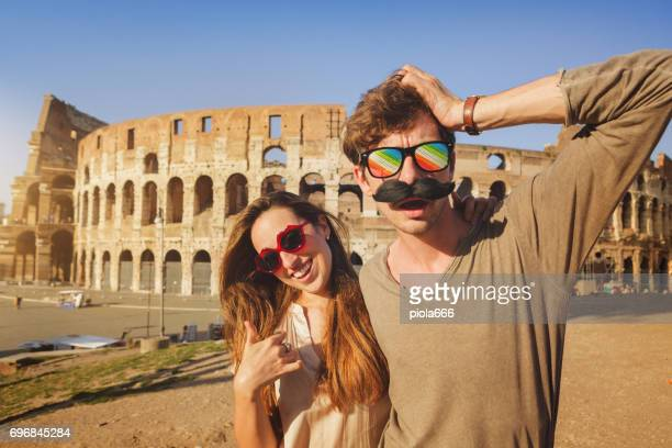 Couple of tourists in Rome with funny glasses