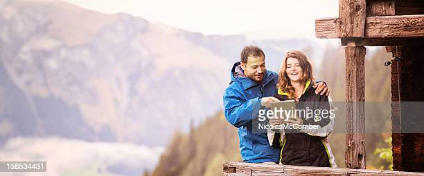 Couple of tourists in Switzerland using digital tablet