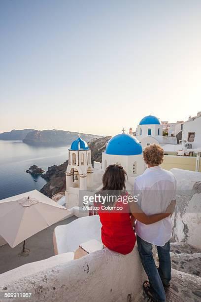 Couple of tourists looking at sunset, Santorini