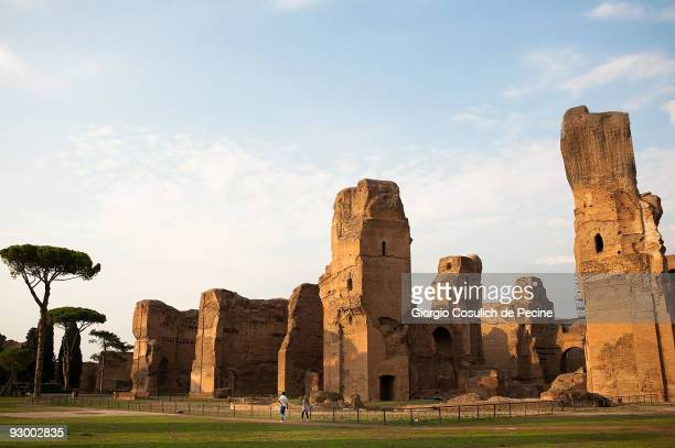 A couple of tourists walk in the archaeological area of the Caracalla's thermal baths in the centre of town on July 27 2009 in Rome Italy Every year...