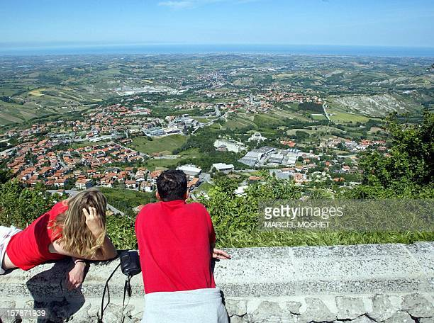 A couple of tourists watch 23 May 2003 the landscape view from San Marino the oldest republic in the world Comprising only 60 square kilometres it is...