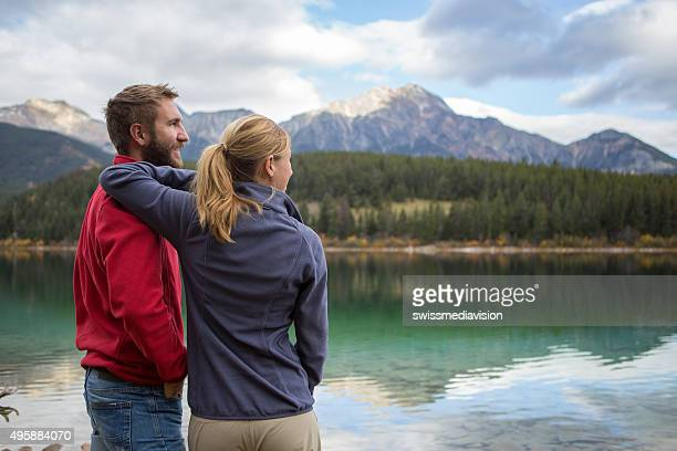 Couple of travelers contemplating the landscape
