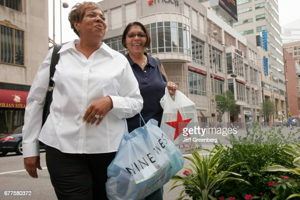 A couple of women with shopping bags in Fountain Square