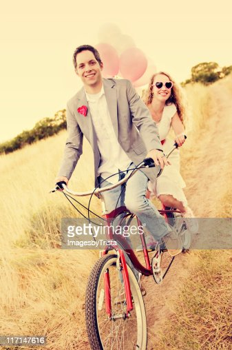 Couple on a Beach Cruiser : Stock Photo