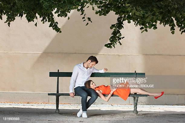 Couple on a bench in a garden, Terrasse De l'Orangerie, Jardin des Tuileries, Paris, Ile-de-France, France