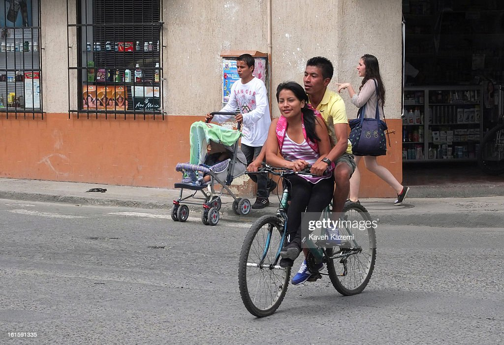 A couple on a bike on January 23, 2013 in Popayan, Colombia.