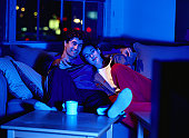 Couple on a Couch Watching Television