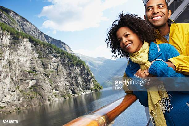 Couple on a Cruise Boat in the Mountains