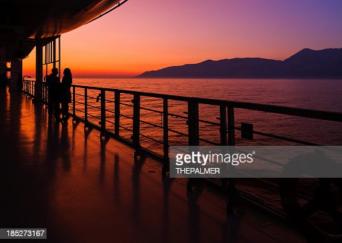 couple on a cruise ship at sunset