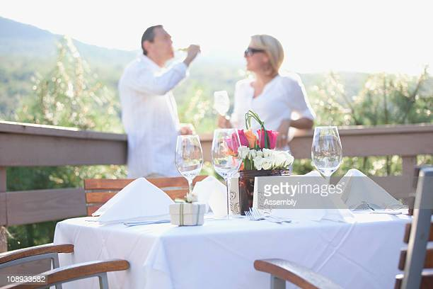 Couple on a deck at an outdoor celebration